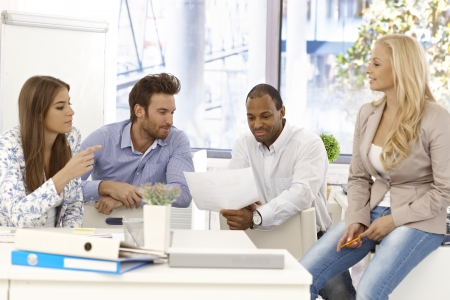Young colleagues working together in bright office. Stock Photo - 17132692