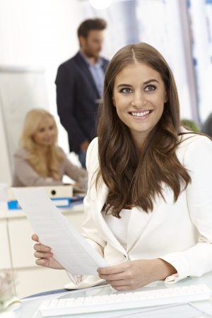 Portrait of beautiful young female office worker working in bright office. Stock Photo - 17134048