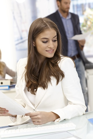 Portrait of attractive young businesswoman looking away. Stock Photo - 17133971