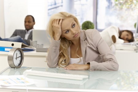 Office workers sitting bored at desk in office, some of them are sleeping. Stock Photo - 17133963
