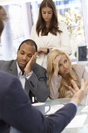 bad leadership: Boss talking to staff. Staff sitting bored.