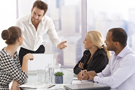 Young businessman presenting to partners in meetingroom. Stock Photo