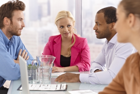 Young businesspeople sitting at a meeting. Stock Photo - 17133973