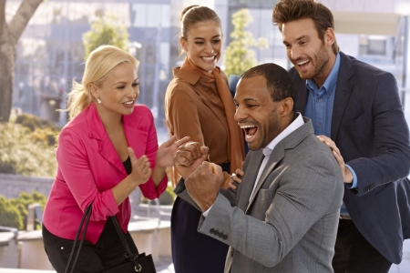 Happy afro businessman and colleagues celebrating success. Stock Photo - 17133933