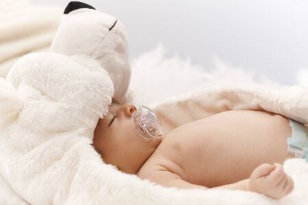 Closeup photo of adorable sleeping newborn baby. Side view. Stock Photo - 17159679