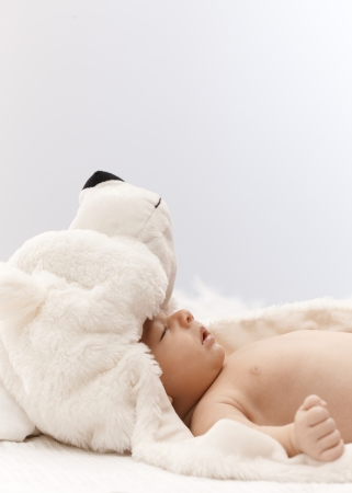 Side view of adorable sleeping infant with big bear hat on head. Stock Photo - 17159673