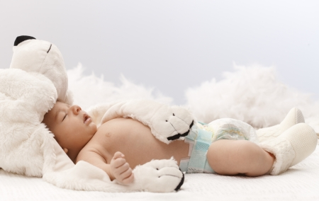 Sleeping newborn baby with big bear hat. Stock Photo - 17159675