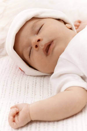 Closeup photo of adorable sleeping infant with mouth open. Stock Photo - 17159681
