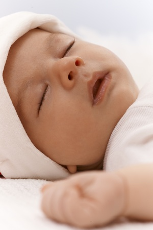 Closeup photo of adorable newborn baby sleeping with mouth open. Stock Photo - 17159638