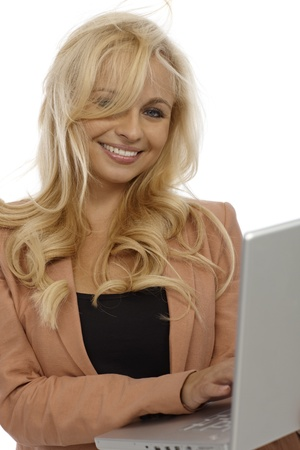 Attractive young blonde businesswoman holding laptop, smiling. photo