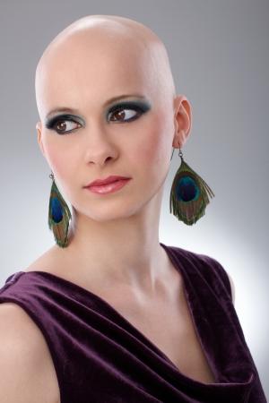 velvet dress: Studio portrait of bald woman wearing elegant claret velvet dress. Stock Photo
