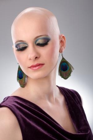 hairless: Studio portrait of hairless woman wearing elegant claret velvet dress.
