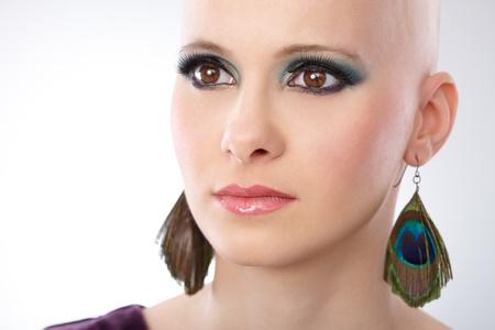 hairless: Studio portrait of bald woman looking away