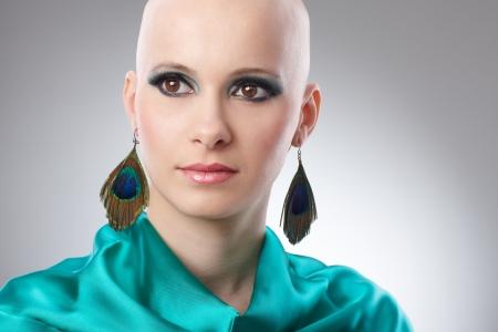 25 30 years women: Beauty portrait of bald woman in turquoise silk dress  65533;