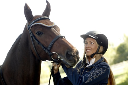 Happy female rider with horse. photo