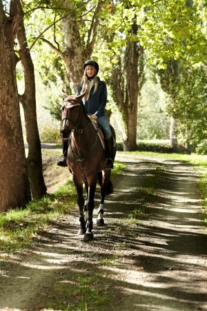 horse blonde: Female rider and horse in the forest. Stock Photo