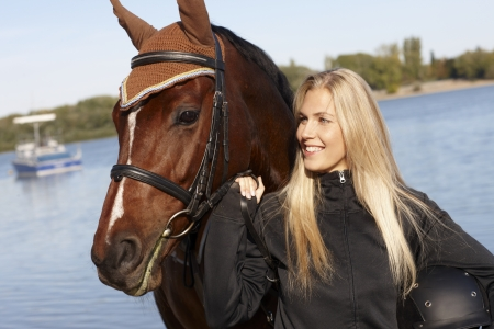 Outdoor portrait of young female rider and horse. Stock Photo - 17369392