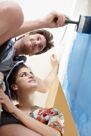 35 years: Young couple painting wall at home, renovating  View from below   65533; Stock Photo