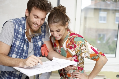 improving: Happy young couple planning new home, DIY   65533;