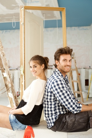 Happy couple building new home, DIY, resting, smiling   65533; photo