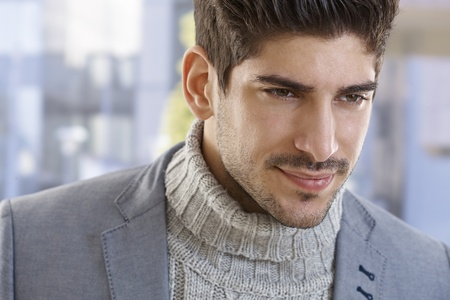 Closeup portrait of goodlooking young casual man, smiling. photo