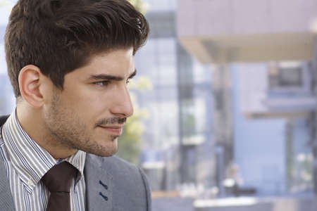 Profile of handsome young businessman outdoors. Stock Photo - 17420599