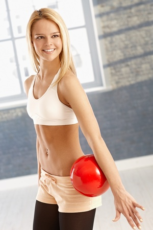 Happy young rhytmic gymnast exercising with ball. Stock Photo - 17505813