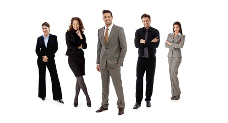 five people: Full-length formal team portrait of businesspeople standing in line looking at camera, smiling. Isolated on white. Stock Photo