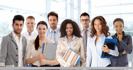 Team portrait of young and successful business people looking at camera, smiling. photo