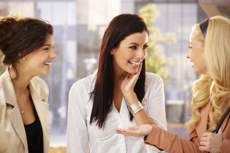 women talking: Pretty female friends chatting, smiling happy outdoors. Stock Photo