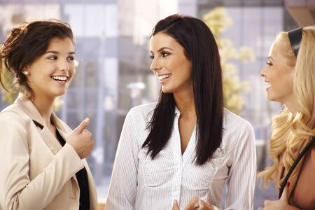 well dressed girl: Attractive female friends talking, smiling outdoors.