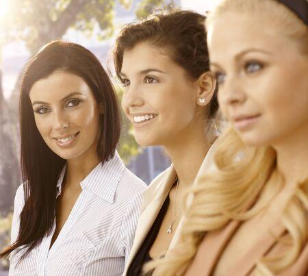 Outdoor portrait of attractive businesswomen. Selective focus. photo