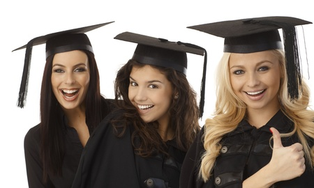 Closeup portrait of beautiful graduates in square academic cap smiling happy. photo