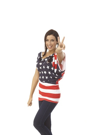 American girl smiling happy showing victory sign. photo
