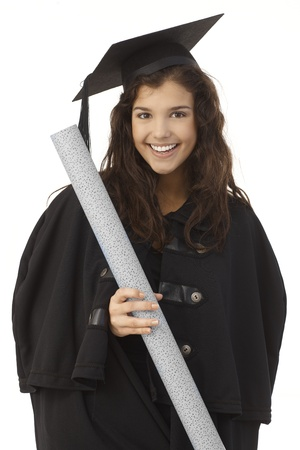 academic dress: Portrait of happy young female graduate in academic dress holding diploma.
