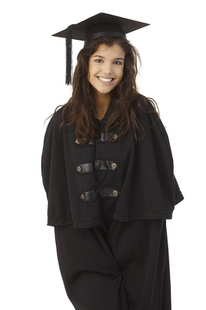 academic dress: Attractive female graduate smiling in academic dress over white background.