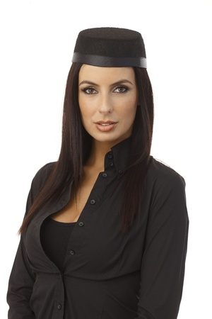 Portrait of attractive young stewardess looking at camera. photo