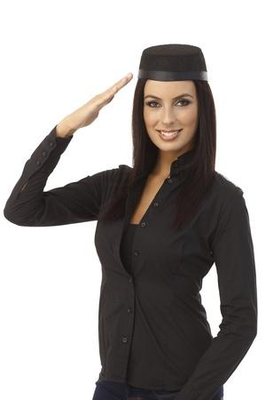 flight attendant: Attractive young stewardess saluting. Stock Photo