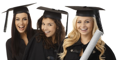 academic dress: Closeup portrait of beautiful young female graduates in square academic cap smiling happy holding diploma. Stock Photo