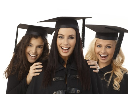 academic dress: Closeup portrait of happy young female graduates in academic dress and square academic cap hugging.  .
