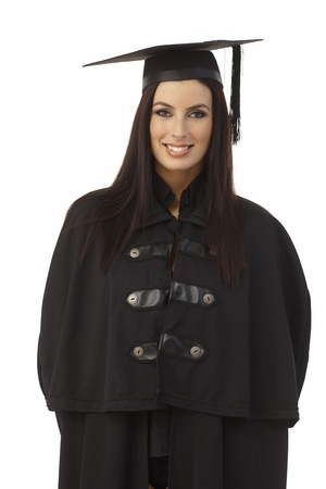 academic dress: Portrait of happy young female graduate in academic dress smiling.