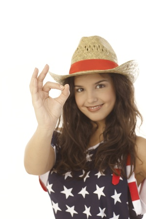 stockphoto: Happy young American woman showing okay sign, focus on hand. Stock Photo