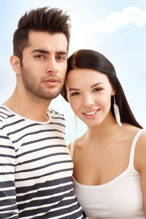 Summer portrait of young loving couple smiling outdoor    photo