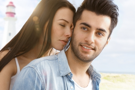 Summer portrait of young attractive loving couple on the beach    photo