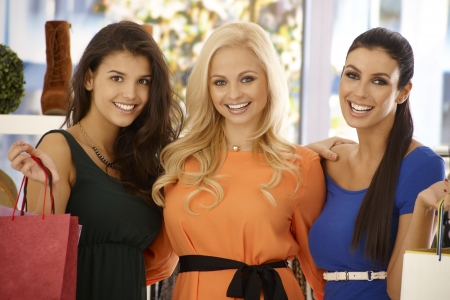 Closeup portrait of three beautiful shopping girls, smiling happy. photo