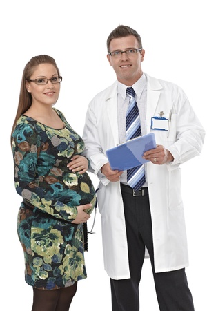 Portrait of doctor and attractive pregnant female patient, smiling. photo