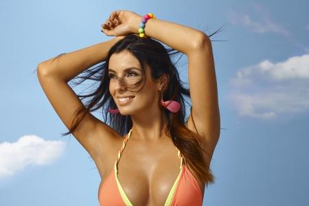 bathing: Summer portrait of beautiful sexy woman in bikini top smiling happy. Stock Photo