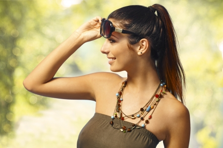 pigtails: Summer portrait of sexy girl in sunglasses with pigtail.