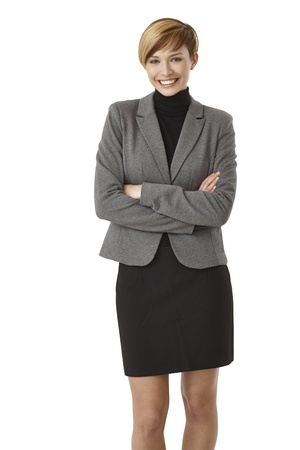 blazer: Young businesswoman standing with arms crossed, smiling. Isolated on white. Stock Photo