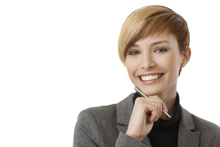 good looking woman: Closeup portrait of happy young businesswoman thinking with pen in hand, smiling. Isolated in white.